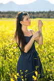 Two young lovers in a field of yellow rapeseed. Royalty Free Stock Photography