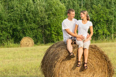 Two young lovers on haystack Stock Image