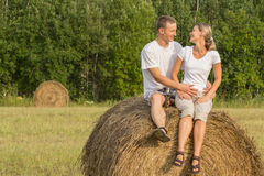 Two young lovers on haystack Royalty Free Stock Photo