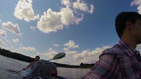 Two young males paddling canoe, action camera, gopro, slowmotion. Stock footage stock footage