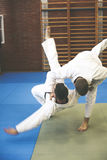 Two young males practicing judo together. Stock Photography