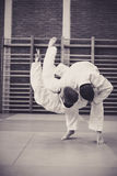 Two young males practicing judo together. Stock Photos