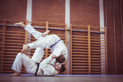 Two young males practicing judo together. Royalty Free Stock Image