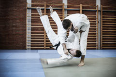 Two young males practicing judo together. Men practicing judo Royalty Free Stock Image
