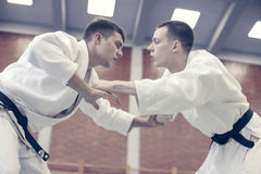 Two young males practicing judo together. Stock Image