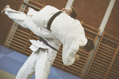 Two young males practicing judo together. Royalty Free Stock Photo
