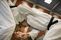 Two young males practicing judo together. Royalty Free Stock Photography
