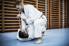 Two young males practicing judo together. Stock Images