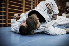 Two young males practicing judo together. Men practicing judo Stock Photography