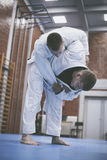 Two young males practicing judo together. Stock Photo