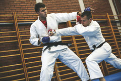 Two young males practicing judo together. Men practicing judo Stock Photo