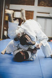 Two young males practicing judo together. Men practicing judo Royalty Free Stock Photography