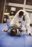 Two young males practicing judo together. Men practicing judo Stock Photos