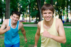 Two young man jogging Stock Photos