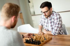Two young man playing chess at home Royalty Free Stock Photography