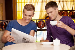 Two young man reading newspaper. Royalty Free Stock Photography