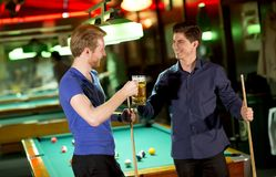 Two young man toasting with a beer royalty free stock photos