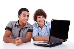 Two young man together on a laptop Stock Photo