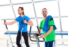 Two young man train with fitness machine Royalty Free Stock Photo