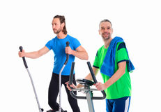 Two young man train with fitness machine. Two young men train with fitness machine in front of white background stock photos