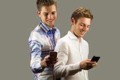 Two young man watch phone smiling Stock Images