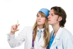 Two young medics are looking at syringe Stock Images