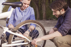 Two young men with bicycles Stock Photography