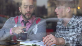 Two young men in a cafe. Creative meeting stock video
