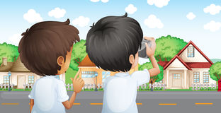 Two young men with a camera Stock Images