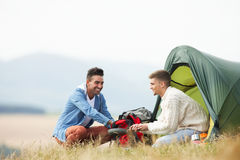 Two Young Men On Camping Trip In Countryside Stock Photography