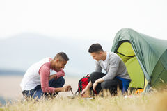 Two Young Men On Camping Trip In Countryside Royalty Free Stock Photography