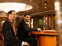 Two young men in a casino Stock Photos