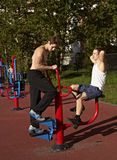 Two young men engaged in sports gym Stock Photos