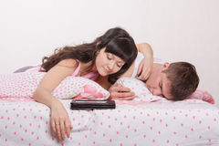 Two young men fell asleep in bed Stock Photos