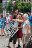 Two Young Men Hugging on Canada Day Stock Image