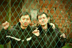 Two young men in iron cage Royalty Free Stock Photo