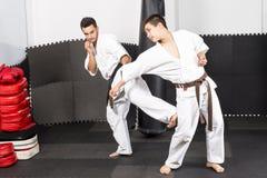 Two young men in kimono fighting- ashihara karate Stock Photos