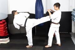 Two young men in kimono fighting- ashihara karate Royalty Free Stock Photos