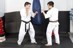 Two young men in kimono fighting- ashihara karate Royalty Free Stock Photo