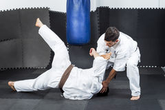 Two young men in kimono fighting during their training Stock Photography