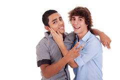 Two young men  laughing and hugging, Stock Image