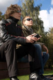 Two young men on a park bench Stock Photography