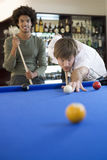 Two young men playing pool royalty free stock photo