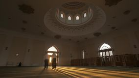 Two men pray in a mosque
