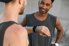 Two young men resting after running workout Stock Images