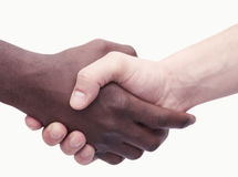 Two young men shaking hands, close-up, studio shot Royalty Free Stock Photography