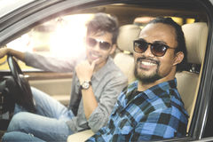 Two young men sitting in the car Royalty Free Stock Photo