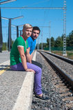 Two young men sitting on the platform Stock Images