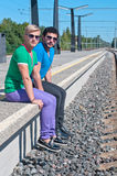 Two young men sitting on the platform Royalty Free Stock Photos