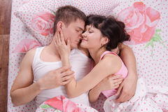 Two young men sleeping in bed Royalty Free Stock Image